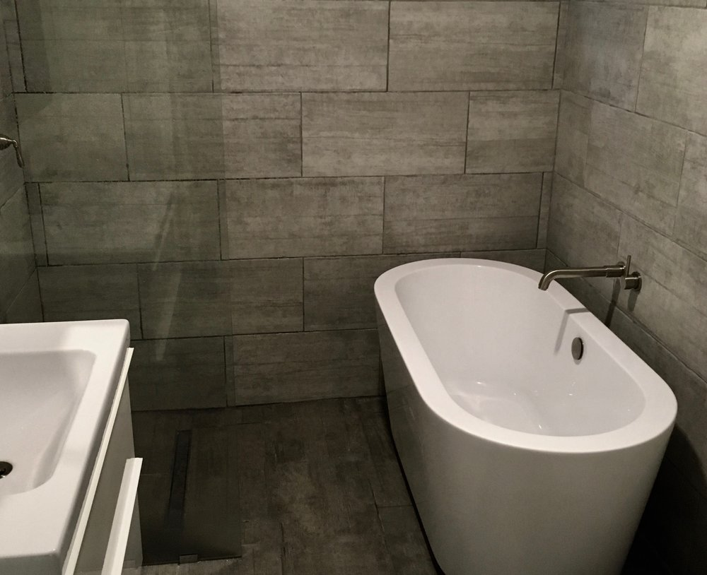 Barrier Free Shower - Though not large, the 840 square foot Itacha Modern house we built offers a European style bathroom wet room with a curbless walk-in shower!