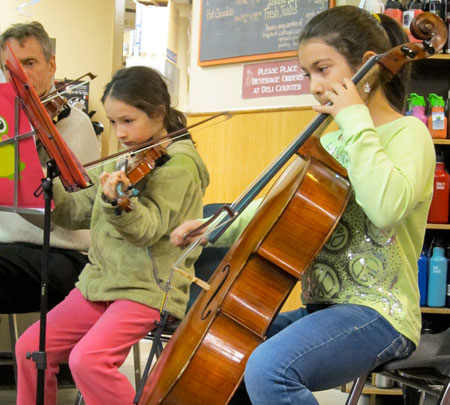 Local music students serenade shoppers on Arts Night Out
