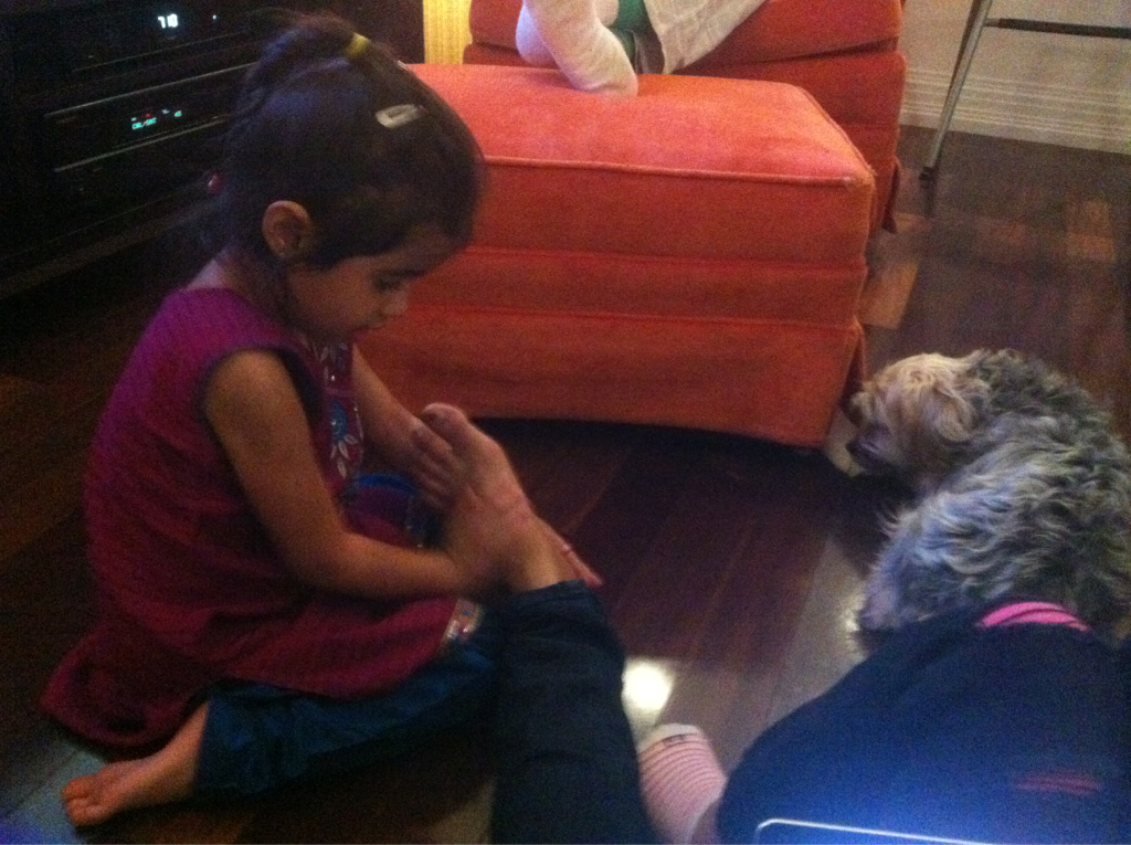 Best thanksgiving memory of 2011: my 3 year old niece massaging my feet. Look, it wasnt child labor. She wanted to do it. She did! For her, it was fun!!     Still, amazing.