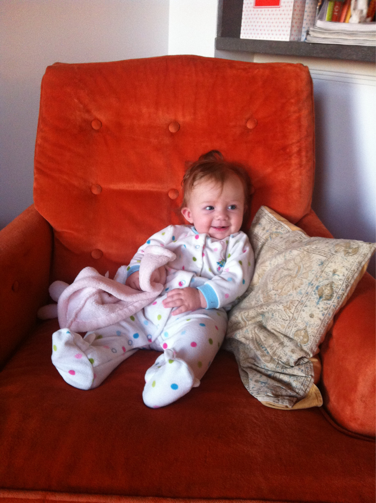 A pretty awesome way to wake up: Hazel takes on the orange chair.