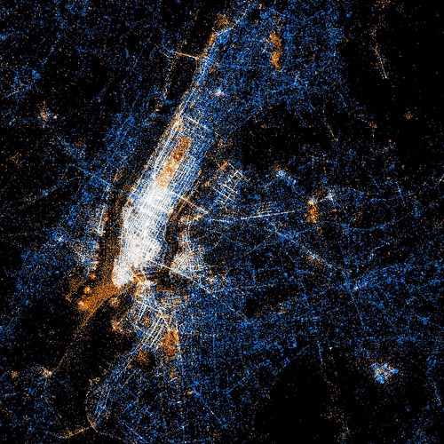 minusmanhattan :     Heat map of tweets and photos by Eric Fischer. The orange dots indicate photos and the blue dots indicate tweets.      Very cool.