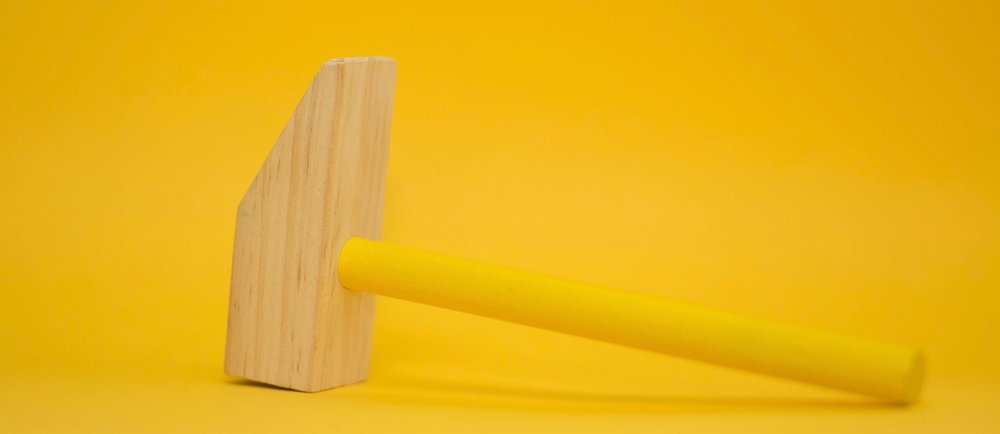 A toy hammer. Photo by  Markus Spiske  on  Unsplash