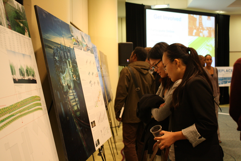 Citizens interacting with displays on Gardiner Expressway East designs.