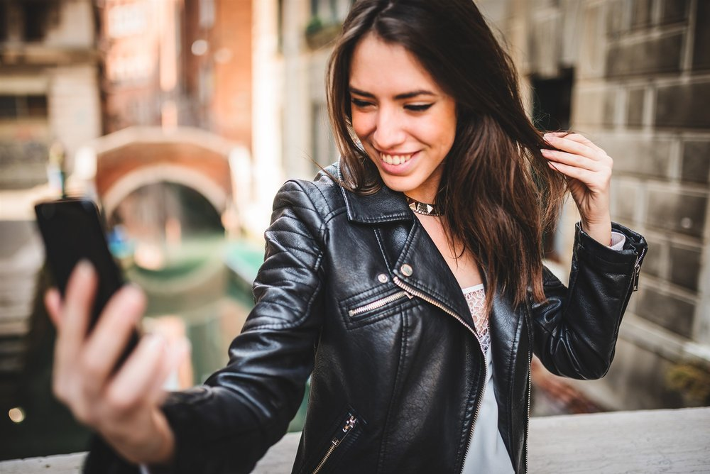 180405-woman-selfie-happy-leather-jacket-ac-521p_50968d772855f062a817c92443d6eda4.fit-2000w.jpg