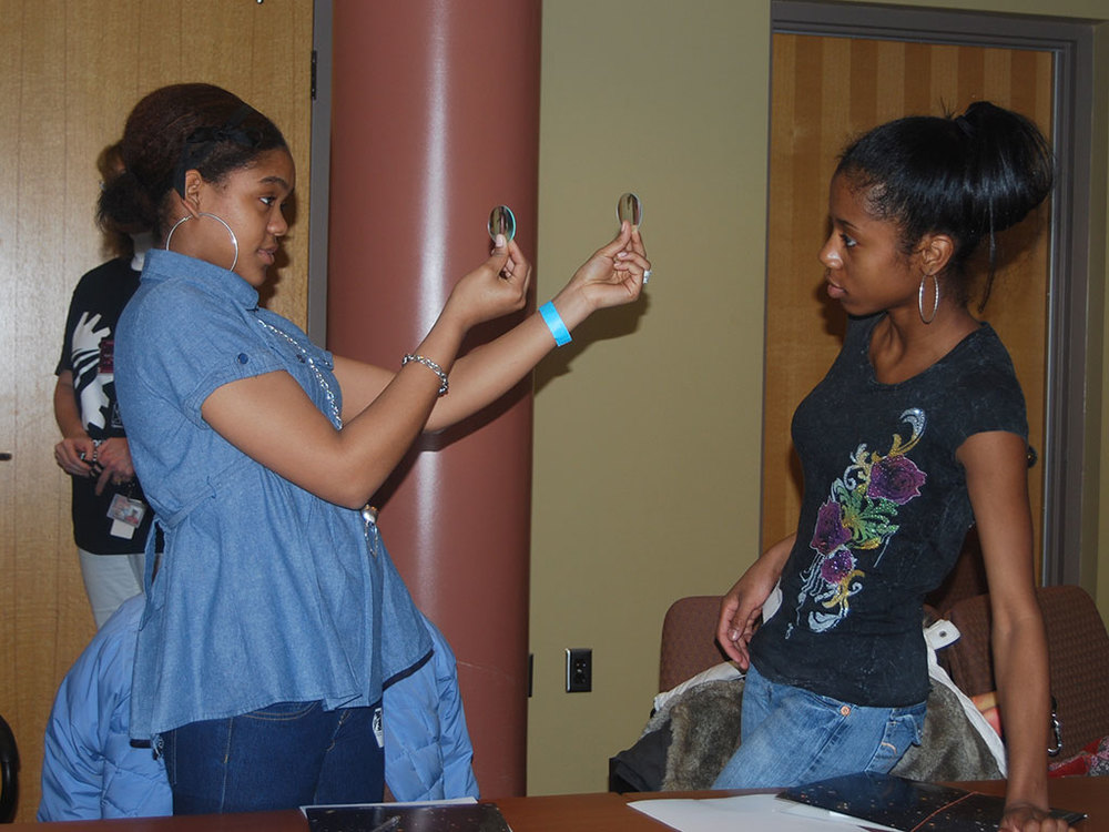 Students take part in hands-on activities while exploring career opportunities at the Women's Science Forum.
