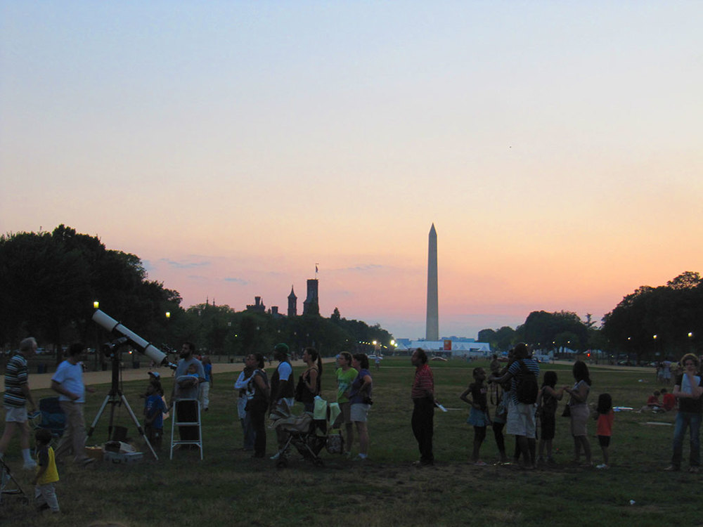 Visitors line up on the National Mall for a glimpse through a telescope.  Credit: Vanessa Thomas (STScI)