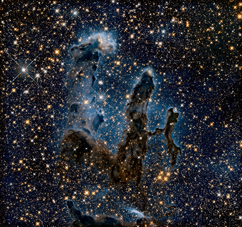Hubble's near-infrared camera allows us to see into dust clouds and beyond the dust and gas of the Eagle Nebula, into deeper space. Hubble Space Telescope, 2014. NASA, ESA, and the Hubble Heritage Team (STScI/AURA)