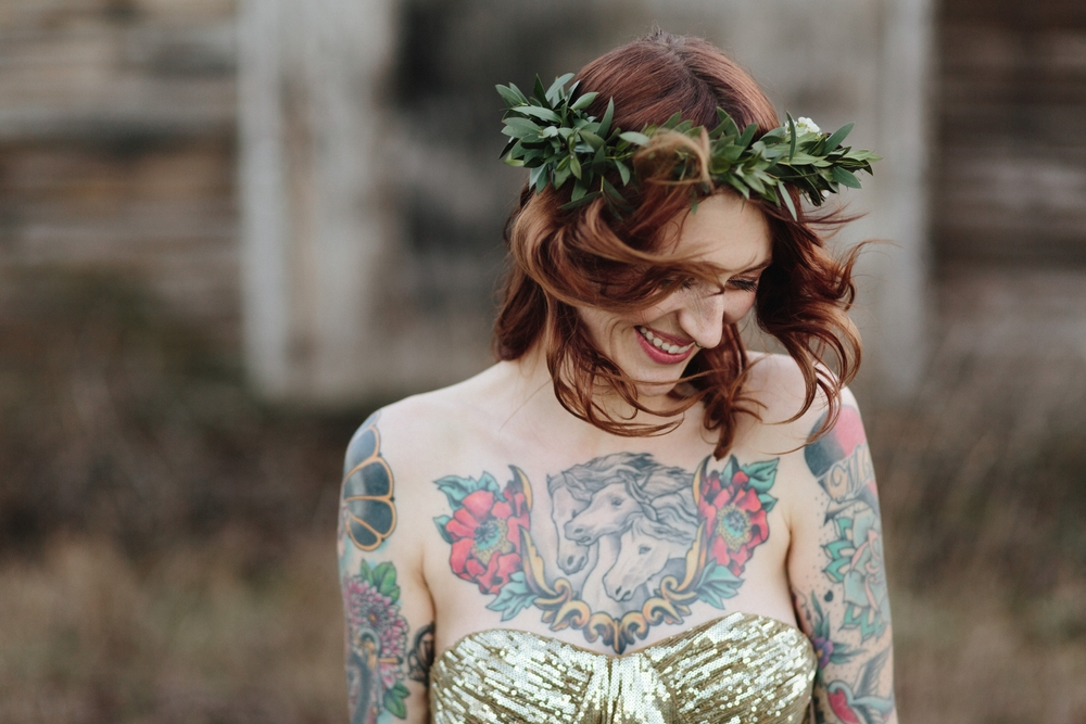 A wind-swept bride during portraits by Portland wedding photographer Catalina Jean.