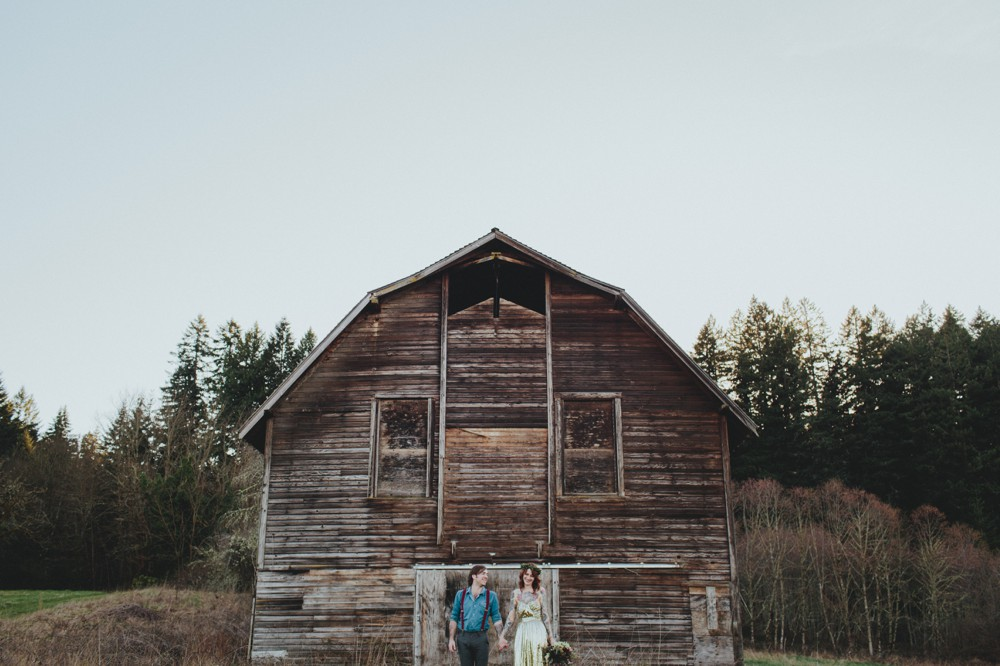 A sweet bride + groom by a barn by Portland wedding photographer Catalina Jean