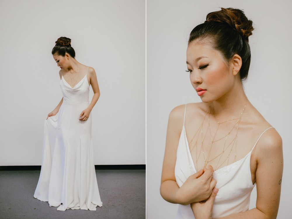 A bride in an elegant wedding dress and gold body chain
