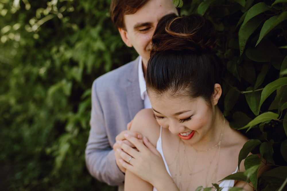 A couple cuddles together by Portland wedding photography Catalina Jean
