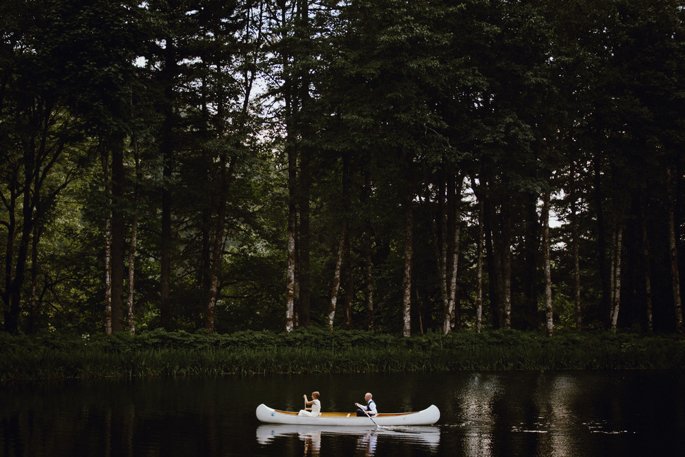A bride and groom in a canoe at Bridal Veil Lakes in Oregon