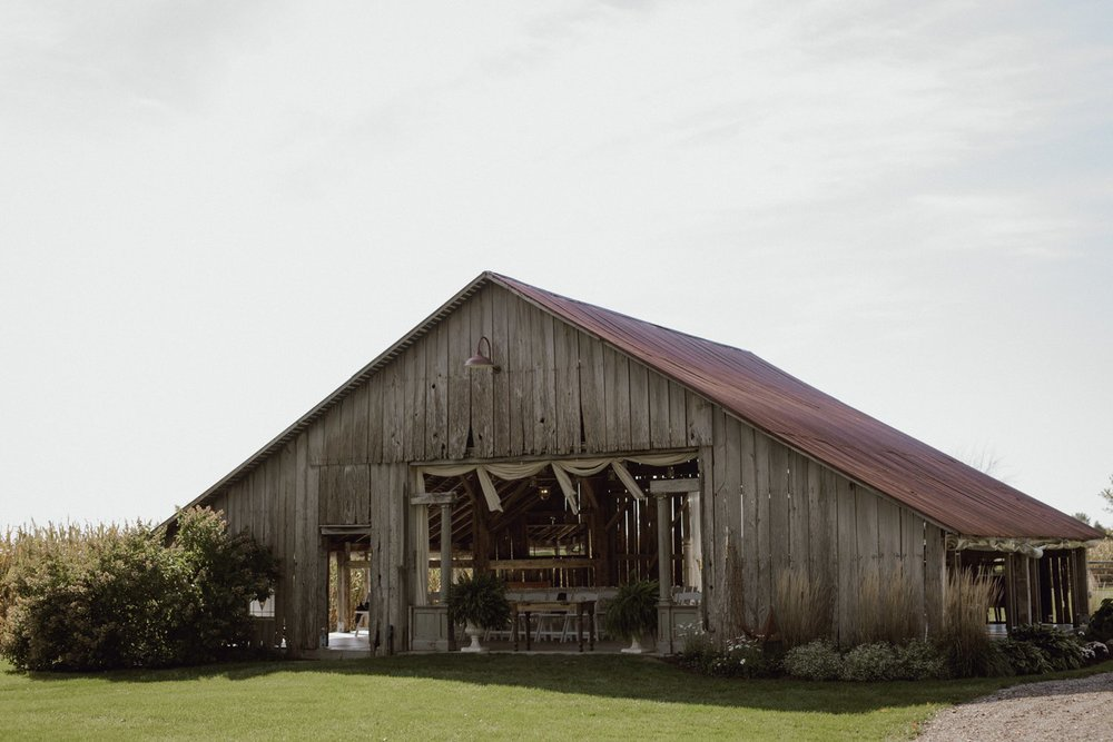 The Farmhouse Weddings ceremony site in the barn