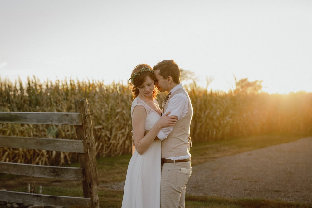 The Farmhouse Weddings bride and groom sunset photo