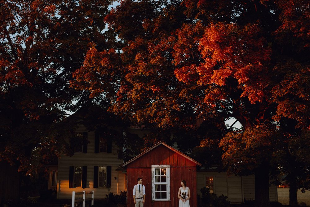 Falls colors with a bride and groom at their wedding