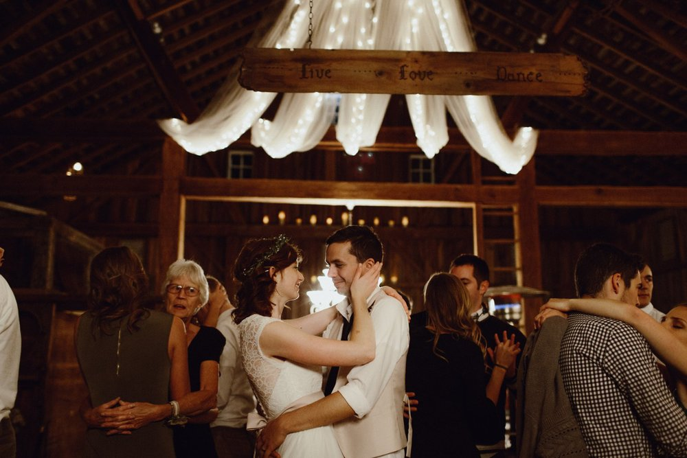 The bride and groom dancing at their reception at The Farmhouse Weddings in Indiana