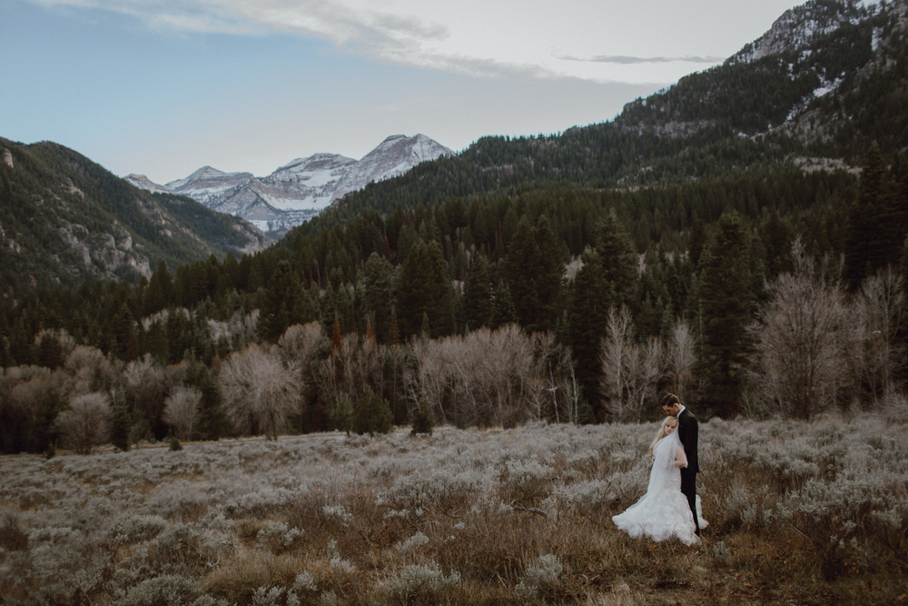 A bride and groom with mountains in the background
