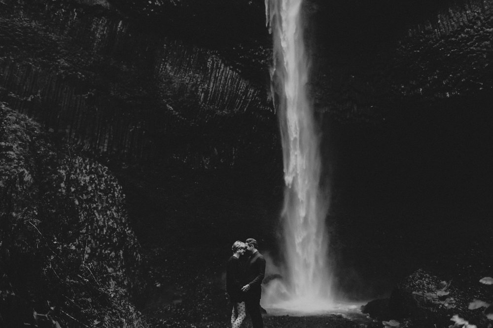 Waterfall engagement photo in black and white