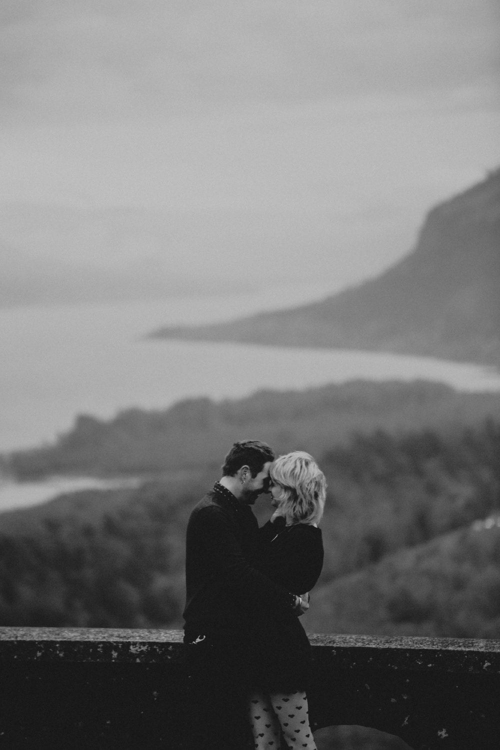 An engagement photo with the Columbia Gorge in the background