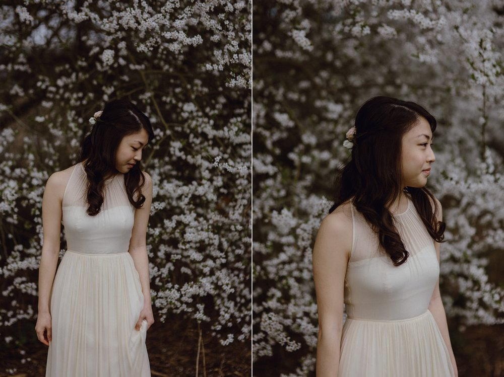 A photo of a bride surrounded by white flowers at her Portland wedding