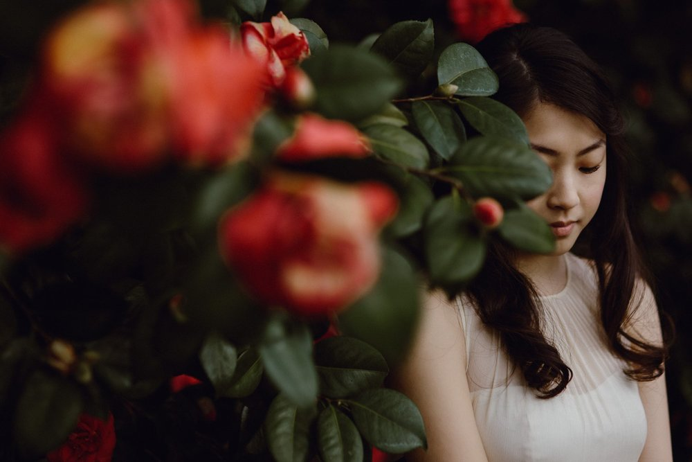A bride among spring flowers at her Portland Oregon wedding by photographer Catalina Jean