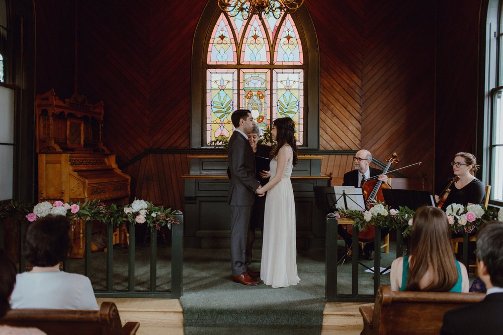 A couple at the alter during their Portland wedding at Oaks Pioneer Church