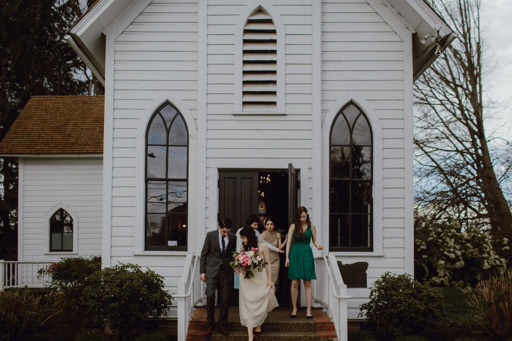 The guests exit a wedding at Oaks Pioneer Church in Portland OR