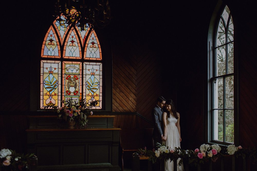 A photo of the bride and groom at Oaks Pioneer Church in Portland, OR