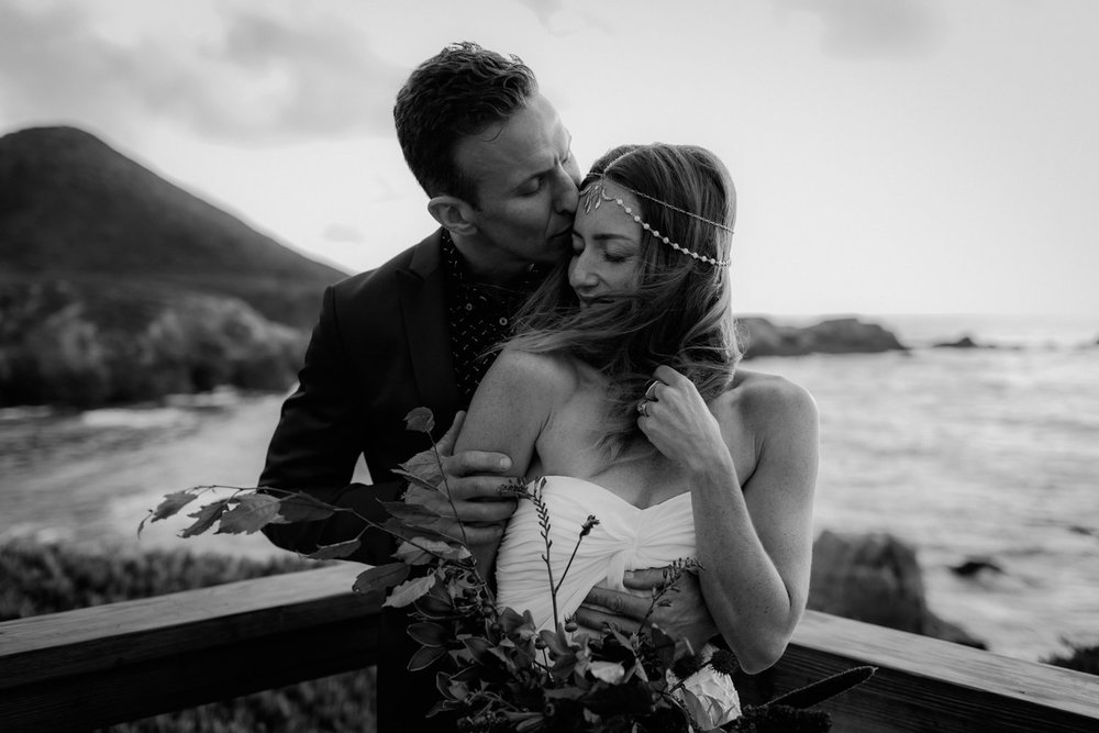 A black and white candid wedding photo by Catalina Jean Photography