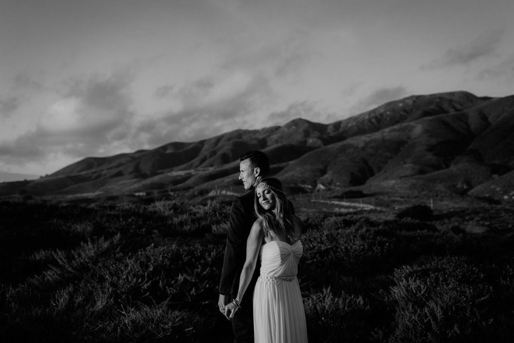 Black and white candid romantic portrait of a bride and groom