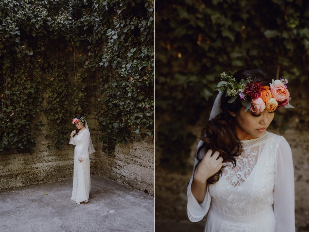 Bride with a bright jewel toned flower crown wedding inspiration