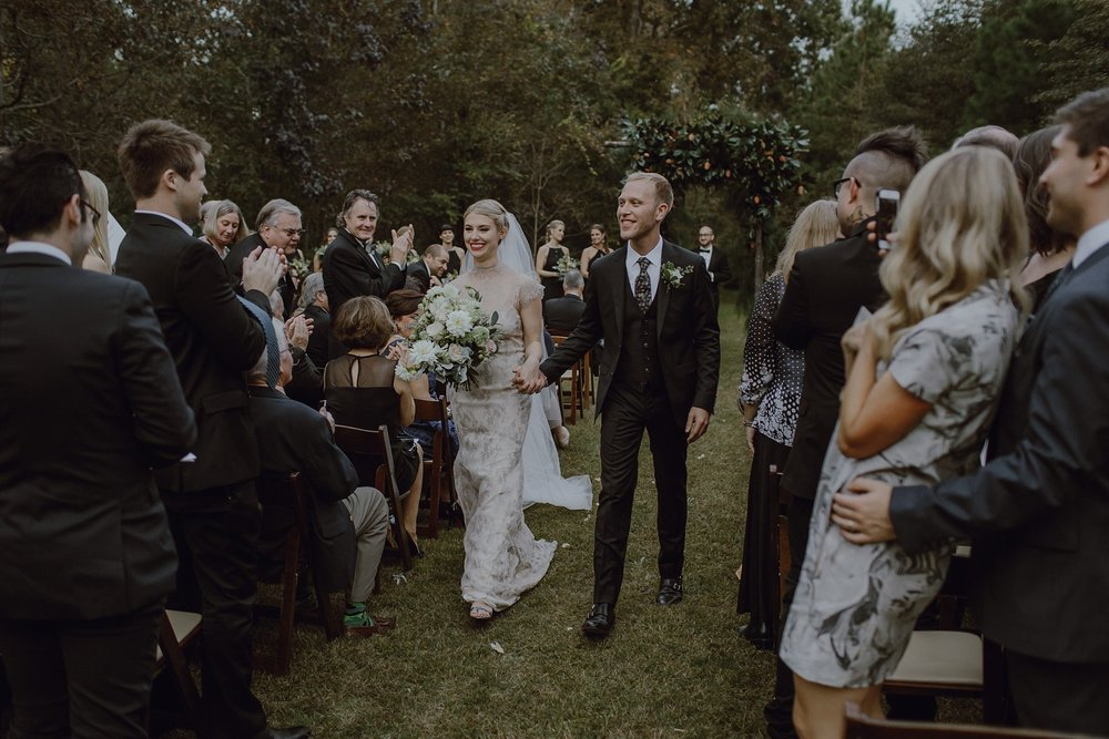 A bride and groom walk down the aisle after they were married