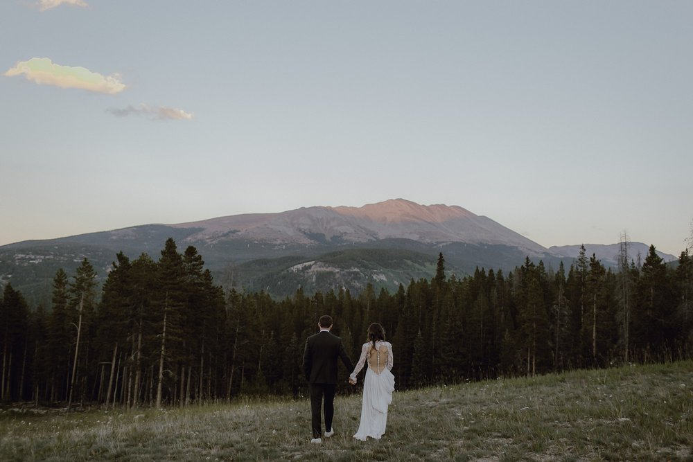 A bride and groom up in the mountains at Breckenridge, CO