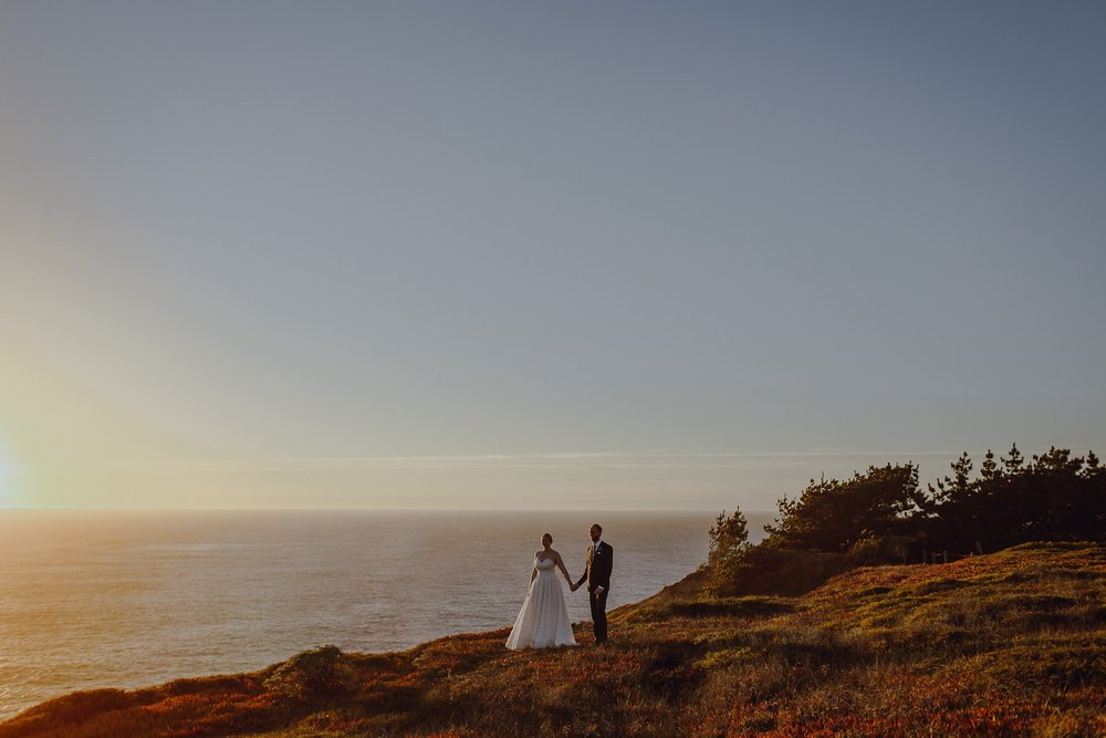 A beach portrait of a bride and groom at their Sausalito wedding