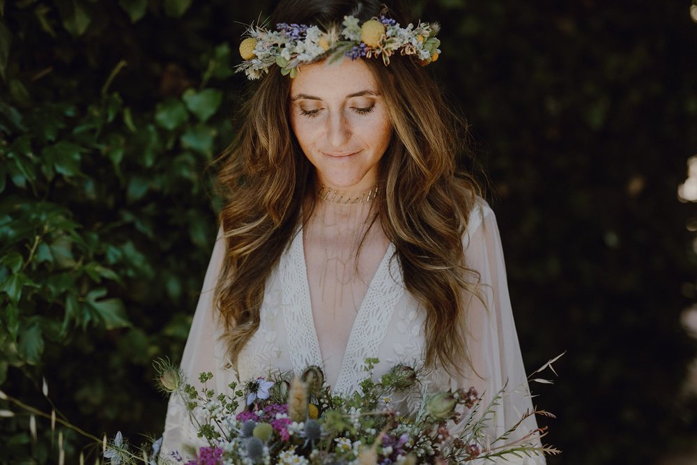 A bride with a flower crown by Kate Healey of Big Sur Flowers