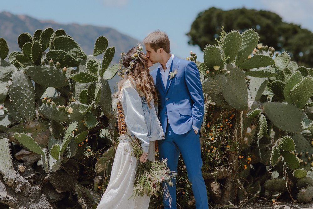 A wedding photo with cactuses