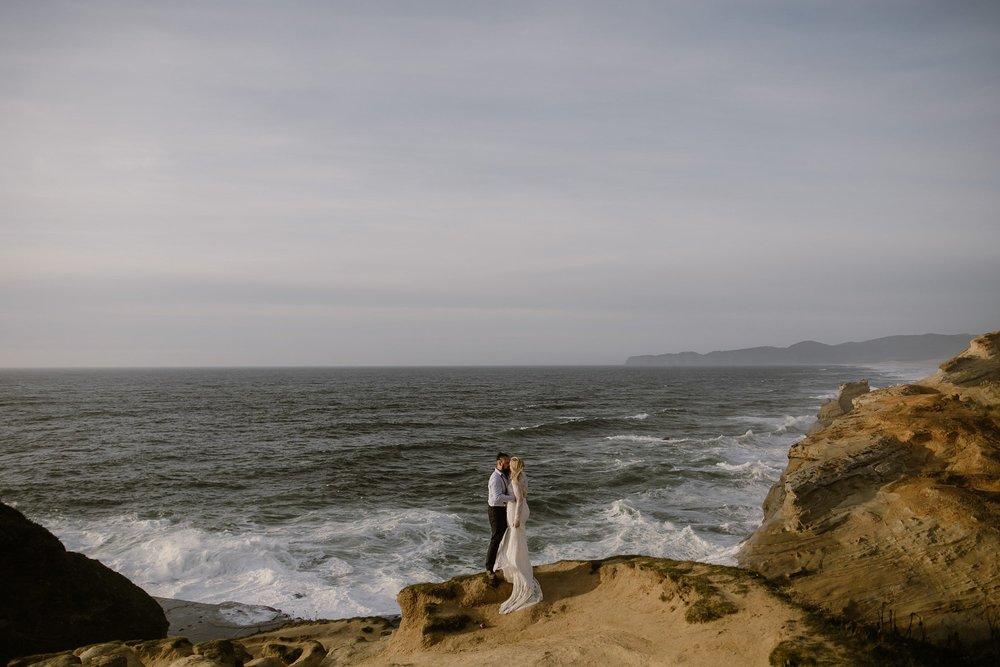 A couple hugs at their Oregon Coast Cape Kiwanda Elopement Wedding