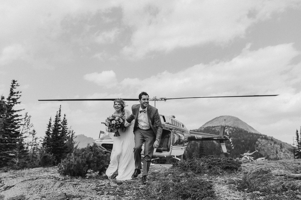 Bride and groom at their helicopter elopement in Banff National Park
