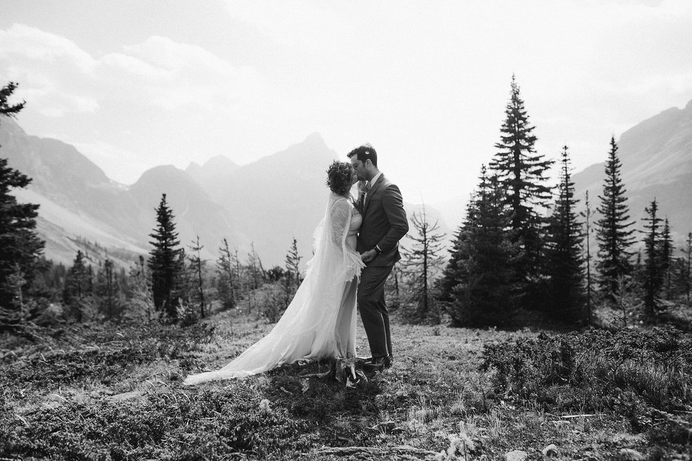A bride and groom's first kiss in Banff