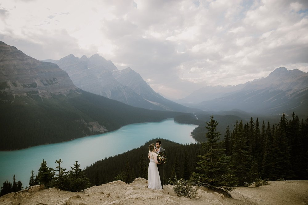 Bride and groom at Peyto Lake in Alberta Canada