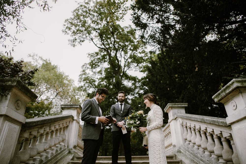 A bride and groom share their vows at their wedding at Parc Monceau