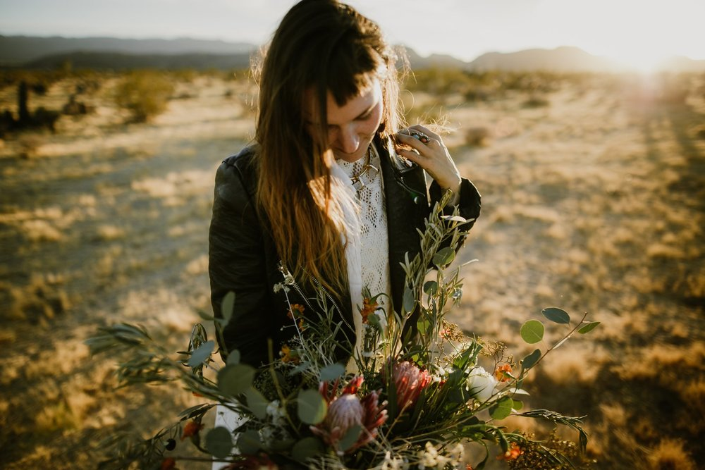 The bride in a motorcycle jacket and a wild boho wedding bouquet