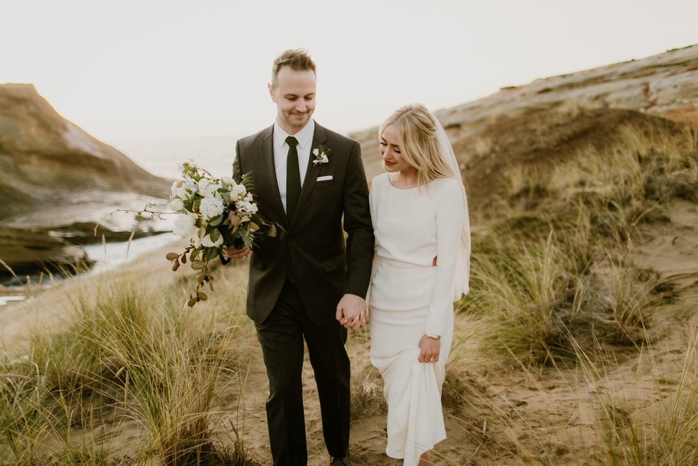 A bride and groom walk together at their Oregon elopement