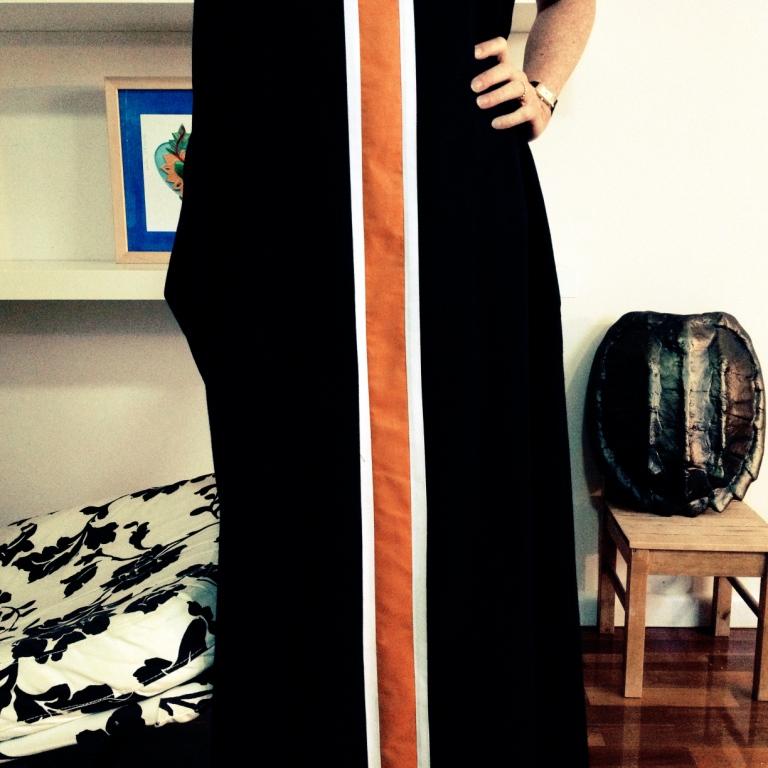 Maxi length, uses a whole lot of fabric but feels goddess like.