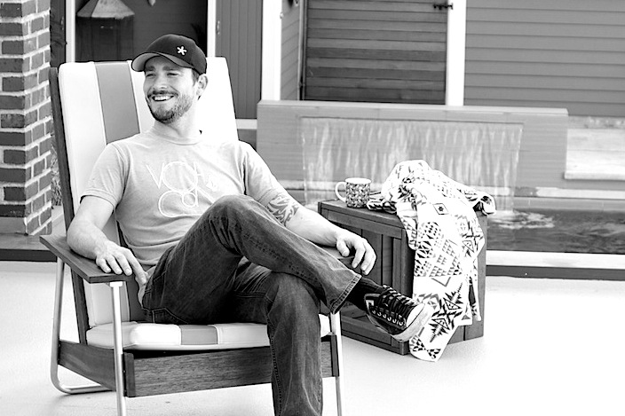 Joe Gibson modeling the Belmont Lounge Chair at a photo shoot .