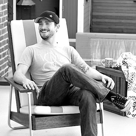 RDH designer Joe Gibson on belmont chair.jpg