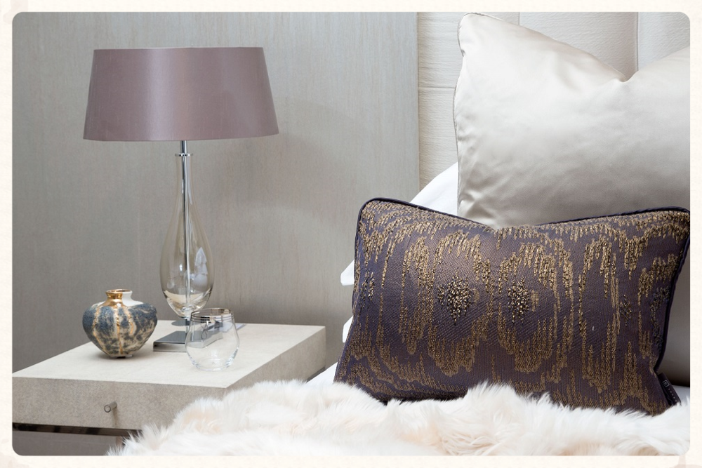 Featured: The Walton Smoked Glass table lamp and Barbican cushions