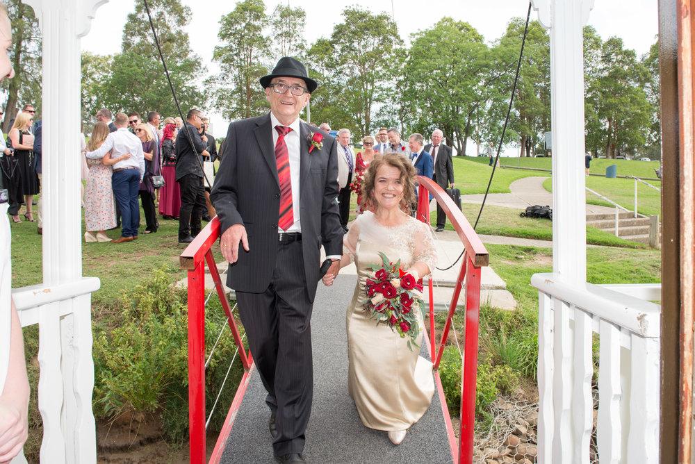 Belle wedding gangway board enter bride groom red jetty guests.jpg