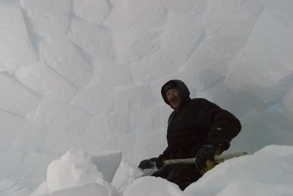 Inuit Elder Building an Igloo on the Winter Trail, Nunavik, Canadian Arctic