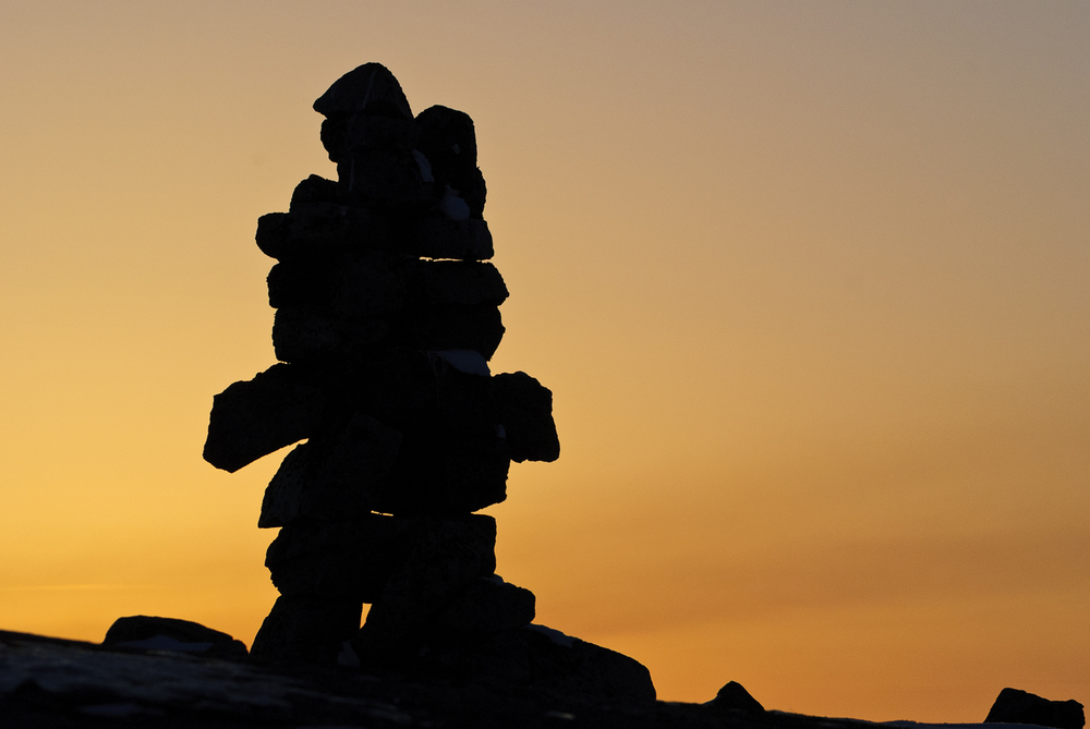 An Ancient Inukshuk Guides The Way At Sunset - Hudson Bay Coast, Nunavik, Canadian Arctic